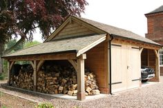 Wowser of an oak car port, workshop and double log store. Sherwood Oak.