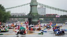 Rowing boats begin to gather near Hammersmith Bridge on the River Thames, during the Diamond Jubilee river pageant in London on Sunday, June 3, 2012. (AP /Anthony Devlin/PA)