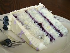 lemon blueberry    2 sticks (8 ounces) unsalted butter, at room temperature  2 cups sugar  2 tsp grated lemon zest  1½ tsp lemon extract  7 egg whites  3 cups cake flour  4 tsp baking powder  ½ tsp salt  1¼ cups milk  Preheat the oven to 350 degrees F. Butter the bottom and sides of three 8 inch round cake pans. Line the bottom of each pan with
