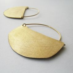 Barbora collection. Designed by Anna Codina. Irregular semi-circular shapes either singly or juxtaposed on each other. 2 finishes: black-plated silver, engraved by hand; matt gold-plated metal, engraved by hand. #annacodina #joidartSS14 #joidart #barcelona #joidartsunnydays #contemporaryjewelry #contemporaryjewellery