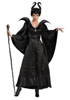 """Disney's Maleficent Christening Gown Costume - Calgary, Alberta. This is Maleficent, from the Disney movie of the same name. The unique twist on the tale of Sleeping Beauty has a new look for the """"evil"""" character. Dressed all in black, with black twisted horns; Maleficent has a beautiful but terrifying look. Pairs well with the Aurora Coronation dress. We'll be sure you'll conjure up a great time at your event. Awesome for Halloween, Disney or villain parties, or just for fun."""