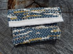 A fun modern change purse made to fit in your everyday bag. Made with upcycled fabrics and metal snaps that have beem hand sewn in. https://www.etsy.com/listing/546905452/blue-white-with-yellow-and-brown-accents #bagsandpurses #blue #etsy #clutch #JessieMayDesigns #handwoven http://etsy.me/2nRE2Sw