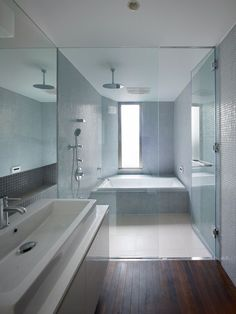 Love the mosaic blue tiles and the tub / shower combo enclosure.