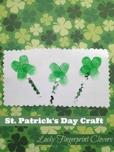 Fingerprints become adorable clovers.  Click to see our other St. Patrick's Day Craft Ideas!