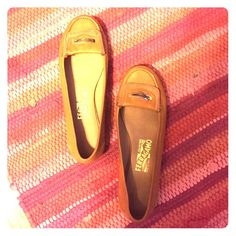 Mustard yellow Salvatore Ferragamo flats Only worn a few times. Love these shoes but they are too small! Mustard yellow authentic Salvatore Ferragamo shoes Salvatore Ferragamo Shoes Flats & Loafers