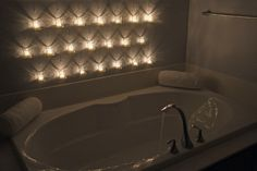 hanging candles on bathroom wall.. looks so relaxing