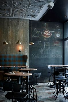 The reclaimed wood walls, metal ceiling tiles, and industrial furniture create a warm and cozy feel. Gunmetal accents work perfectly with this industrial modern feel. Love!!