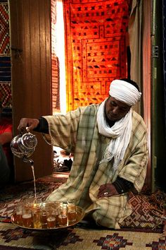 The pouring of tea in Tinghir. Tinghir is a city south of the High Atlas and north of the Little Atlas in southeastern Morocco.