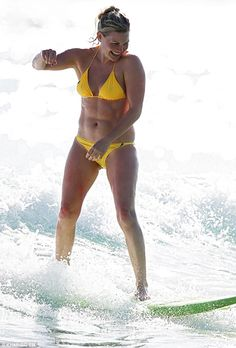Hard core! Bonnie Sveen catches a wave on Bondi Beach showcasing her very impressive abs...