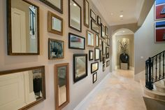 gallery walls with mirrors.  Wall color is Benjamin Moore Shaker Beige.