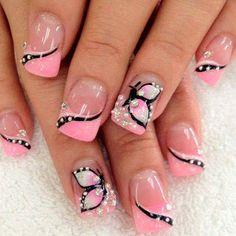 Mostrando uñas decoradas mariposa.jpg