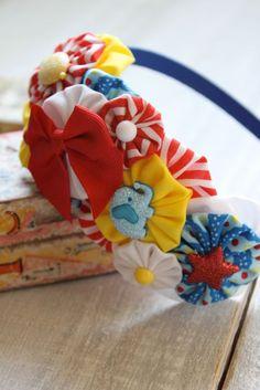 The Circus is Coming to Town- Fabric YoYo Headband. $14.00, via Etsy.