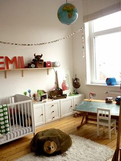 I love the elements of this room for a kids space, esp the chalkboard desk, but wit different composition