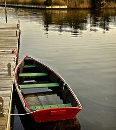 red rowboat  by Alida's Photos, via Flickr