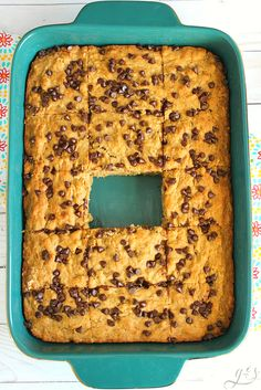 The BEST Banana Bread Blondies | These cake-like brownies use gluten-free flour, coconut sugar, plain Greek yogurt, and mini chocolate chips to top off the healthy dessert recipe. Easy baking recipes such as these are just what clean eating cooks need in their back pocket. From the box mixes are out the window with this simple option. #snack #simple #chocolate
