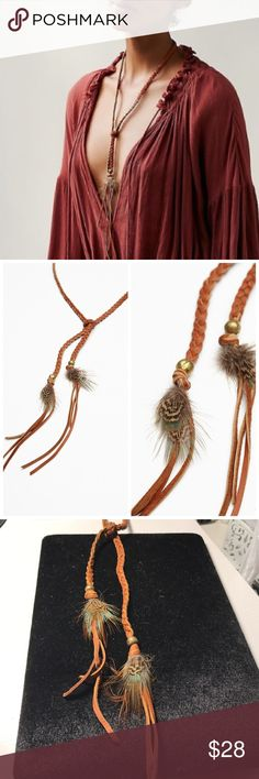 Free People desert dune wrap bolo astali Brand new with tags. Made in Southern California, this braided leather wrap bolo features metal beads and feather accents. Can be worn as a wrap bracelet, bolo necklace, headband, hat accessory or belt. Astali for Free People Free People Jewelry Necklaces