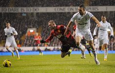Wayne Rooney appears to be fouled by Steven Caulker in the box but no penalty is given