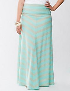 Go ahead and glitter: the shimmering mitered stripes and ultra-soft feel of this knit maxi skirt by Seven7 has your sun-loving style made in the shade. Easy-wearing maxi pulls on with a flattering A-line cut, plus a wide waistband to define your shape and a trendy long length that's perfect with your favorite sandals. Lined to the knee for a gorgeous drape.