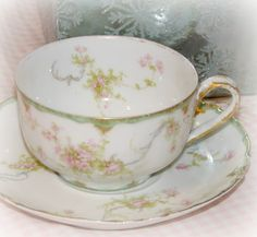 Limoges- looks like one of our patterns, except with more green in the trim.