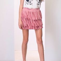 """DUSTY PINK BOHO FRINGE MINI SKIRT COMING SOON! Boho Fringe dusty pink mini skirt. April has said """"One of my favorite items in my closet"""". True to size. 14"""" long in Small and Medium and 16"""" long in Large. 50% cotton 35% polyester, 15% spandex. I will lower the price to $52.00 once they arrive. No trades and a smoke free home. Thank you for stopping by @treasuresbytrac  April Spirit Skirts Mini"""