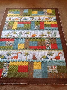 Dinosaur quilt made with Michael Miller by TheGoodLifeQuilt