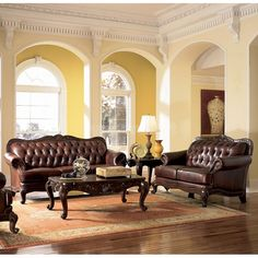 Victoria Leather Living Room Set and I love the yellow walls with the archways!
