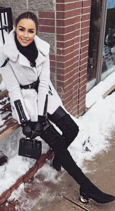 Olivia Culpo': Purse – Strathberry  Ear muffs – Uggs  Coat – Mackage  Pants – J Brand  Gloves – Kate Spade  Shoes – Nicholas Kirkwood