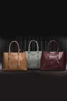 Get a handle on Prada's handbags for fall 2014 in new hues for the season.