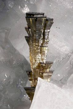 Wurtzite skyscraper  Resembling some kind of habitat around a distant asteroid on a science fiction book cover, these prisms of zinc sulphide are made of a close cousin of the zinc sulphide sphalerite (see http://on.fb.me/1GaU0GY). Wurtzite shares the same chemical formula but crystallises in a different structure, quite a common feature in the mineral world with the varied forms being known as polymorphs (from the Greek for many shapes). It has another unusual feature to its structure…