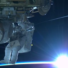 """""""@Astro_Terry at #sunrise. The wire you see glistening is his safety tether."""" #AstroButch #spacewalk #USEVA29"""