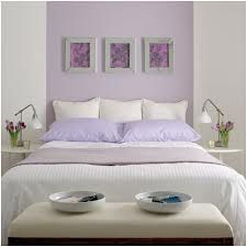 lilac bedrooms, one lilac wall, lilac pillows, white and pops of green (perhaps brown)