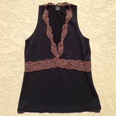 Anthropologie Lace Tank This is a super cute tank. It's black with brown lace. It's 90% nylon, 10% lycra. Brand is Only Hearts by Helena Stuart, purchased from Anthropologie. I wore this a few times , it's in great condition!!!👠 Only Hearts Tops Tank Tops
