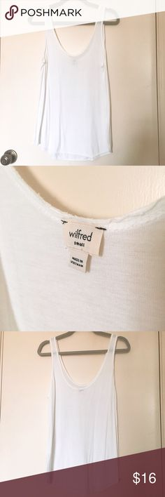 "Aritzia Wilfred White Tank Buttery soft 100% rayon top. Loose and comfortable. Runs pretty large for ""small."" Perfect for spring! Aritzia Tops Tank Tops"