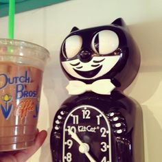 Feeling as excited as this Kit-Cat clock with a White Chocolate Mocha from @dutchbrosarizona, in my hand. These happy cats are also available in red and green. #theclutterhouse #kitcatclock #homedecor