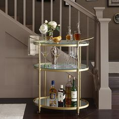 Get 1930's glamour with this gold metal framed bar cart. The top 2 shelves are glass and the bottom shelf is mirror. Low profile wheels. Assembly required.