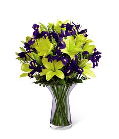 The Spring Time Bouquet features gorgeous yellow lilies and stunning irises.