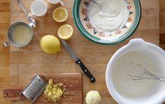 A set of ingredients for lemon mousse, including lemon rind, juice, yogurt and condensed milk