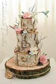 "Gorgeous wedding cake with initials ""carved"" in the wood!"