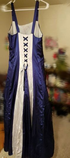 Reconditioned/Certified - 100% Silk Navy Blue Dress Size 12/13 Tailor made Back side Light blue down the back with a navt blue lace only worn once...its been in my closet and it's time to let go of it.