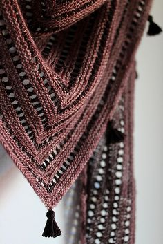 Unilintu is a triangular top-down shawl/scarf. The shape of the shawl is a horizontally wide and vertically shallow triangle. Alternating garter stitch and eyelet rows create a simple stripey texture. Poncho Knitting Patterns, Shawl Patterns, Knitting Stitches, Hand Knitting, Knitting Buttonholes, Crochet Shawls And Wraps, Knitted Shawls, Women's Shawls, How To Purl Knit