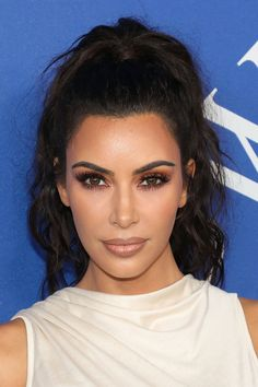 We Haven't Seen Kim Kardashian's Hair Like This in Forever | Kim Kardashian wore an unexpected hairstyle at the 2018 CFDA Awards to accept her Influencer Award. See Kim Kardashian's messy ponytail here.