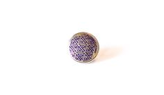 This Mila + Ruby pebble features a modern twist to the ancient Indian symbol of a 'Tee pee', meaning 'Temporary home'.  Made from silver with royal purple deco colouring.  Individually handcrafed in Nepal.