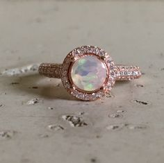 Now available in rose gold which makes this a stunning opal ring for her!