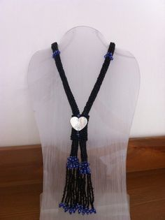 Necklace. Black & blue seed beads, with silver heart. My 2yr old grandson's favourite necklace.