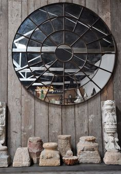 weathered grey wood, earthy ceramics and round mirror