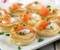 Cream Cheese Pancakes with Smoked Salmon    Serves   10 to 12    For the pancakes:  1 cup all-purpose flour  1 1/4 teaspoon baking powder  1/4 teaspoon kosher salt  1 tablespoon fresh chopped chives  1 ounce cream cheese, softened  1 tablespoon butter, softened  1 egg  3/4 cup milk  8 ounces cold smoked salmon  Freshly chopped chives, for garnish    For the sour cream sauce:  1/2 cup sour cream  1 teaspoon horseradish  1/4 teaspoon kosher salt
