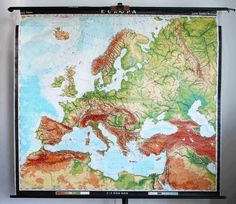 Vintage Physical Map of the European Continent - School Wall Pull Down Chart - World Global Land Geography, Cartography  Here we are offering a vintage school pull-down wall physical map depicting the countries of Europe. Made in Germany from Haack-Painke Justus Perthes Darmstadt (Darmstadt, Germany) and presented at 1:3,000,000 scale. Dates approximately to the 1960s. Printed on paper with a sturdy linen backing and mounted on wood supports. It is a beautifully illustrated map in a very…