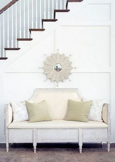 Kind of loving this little settee, & the little mirror.  Cute!