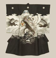 A plain silk miyamairi kimono utilized at Shinto baptism ceremonies, featuring yuzen-dyed and silkscreen motifs of a dragon rising to Mount Fuji. Metallic embroidery highlights.  1940-1960, Japan. The Kimono Gallery