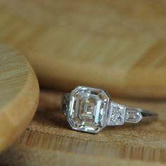 Antique Asscher Cut Diamond Ring with bezel set side stones